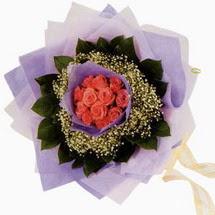 12 adet gül ve elyaflardan   Denizli güvenli kaliteli hızlı çiçek